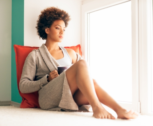 black woman sitting at window